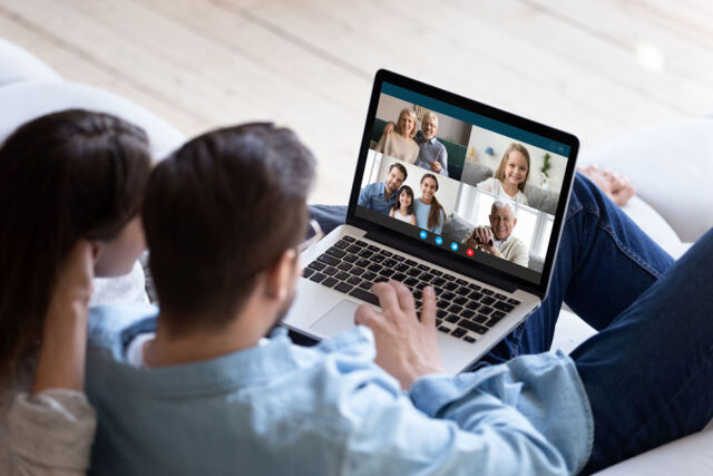 Couple chatting with relatives via videoconference video call application
